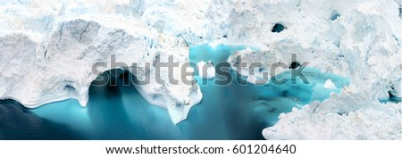 aerial view of the icebergs on arctic ocean at Greenland. Glaciers are melting at north circle of the world. Climate change to close future. #601204640