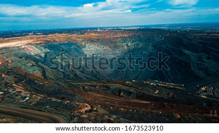 Aerial view of the Iron ore mining, Panorama of an open-cast mine extracting iron ore, preparing for blasting in a quarry mining iron ore, Explosive works on open pit