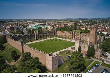 Aerial view of the Italian historic castle Castello Scaligero, view of the Villafranca di Verona. Historical part of the city Villafranca di Verona, Verona, Italy. Flag of Italy at Scaligero Castle. Stok fotoğraf ©