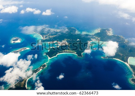 Aerial view of the Japanese tropical islands surrounded by coral reefs with clear blue water, Kerama Islands, Okinawa, Japan