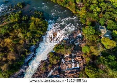 """Aerial view of The Khone Falls and Pha Pheng Falls, waterfalls the """" Niagara of the Asia"""", Champasak Southern Laos. Royalty high-quality free stock photo image of a beautiful waterfall"""
