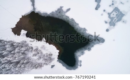 Aerial view of the lake and forest on a cold winter day #767190241