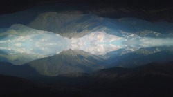 Aerial view of the large mountains covered by green grass and trees against blue and cloudy sky with abstract mirror effect. Shot. Abstract reflection