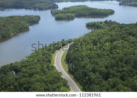Aerial view of the Mississippi River and a curving road near Brainerd, Minnesota
