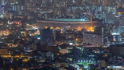 Aerial view of the National stadium in the Peruvian capital Lima from San Cristobal hill night view. Landscape of slum urban area and historic buildings in South America. Peru