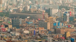Aerial view of the National stadium in the Peruvian capital Lima from San Cristobal hill view. Landscape of slum urban area and historic buildings in South America. Peru