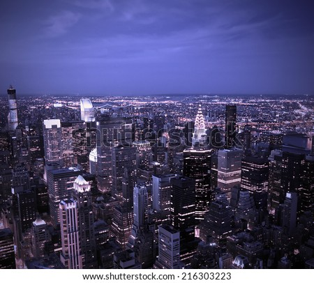 Aerial view of the New York City Skyline at sunset with a blue hue