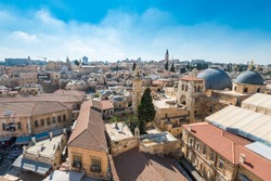 Aerial view of the old city with blue sky of Jerusalem. Muristan   street in Christian quarter and dome of  the Church of the Holy Sepulchre. View from the Lutheran Church of the Redeemer.