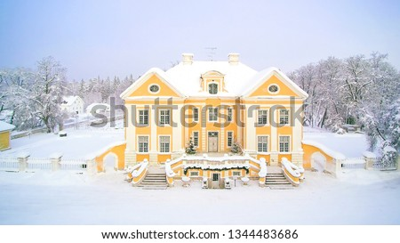 Aerial view of the Palmse manor covered in snow. Palmse Manor is one of the grandest baroque mansions in Estonia. #1344483686