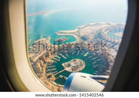 Aerial view of the Pearl-Qatar island in Doha through the airplane porthole. Qatar, the Persian Gulf