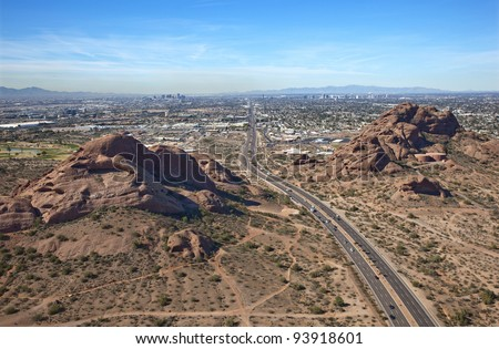 Aerial view of the Phoenix, AZ skyline from behind the Papago Buttes