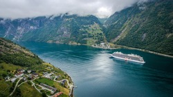 Aerial view of the port of Geiranger, Norway. Geirangerfjord and Geiranger town. Camping near a fjord in Norway
