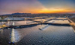 Aerial view of the prawn farm with aerator pump in front of Ninh Phuoc, Ninh Thuan, Vietnam. The growing aquaculture business continuously threatening the nearby wetlands.