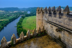 Aerial view of the River Dordogne and of the picturesque French countryside from a clifftop castle.