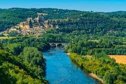 Aerial view of the River Dordogne, Château de Beynac (a fortified clifftop castle) and the Beynac-et-Cazenac village classified as one of the most beautiful villages of France in summer.