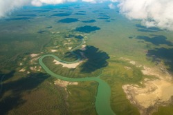 Aerial view of the river flowing landscape in the area of Gove peninsula in Northern Territory state of Australia.