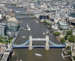 aerial view of the River Thames in London with Tower Bridge in the foreground