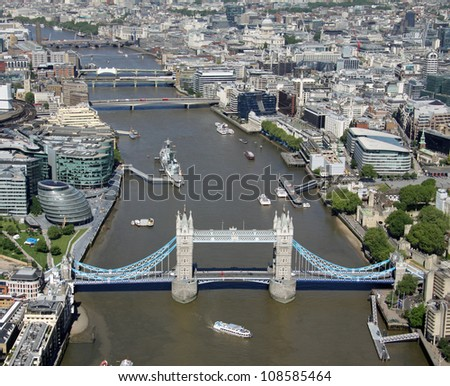 aerial view of the River Thames in London with Tower Bridge in the foreground - stock photo