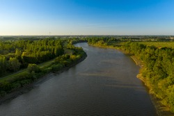 Aerial view of the Scheldt river, at sunset, in Baasrode, East Flanders, Belgium