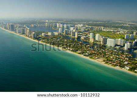 Aerial view of the seashore in Miami show deep green and blue waters