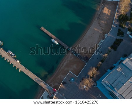 Aerial view of the seashore - turquoise water, piers and boats at the pier #1510425278