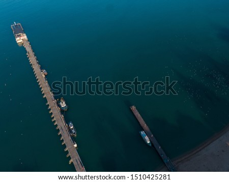 Aerial view of the seashore - turquoise water, piers and boats at the pier #1510425281