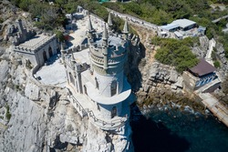 Aerial view of the snow-white castle swallow's nest, built in the Gothic style.