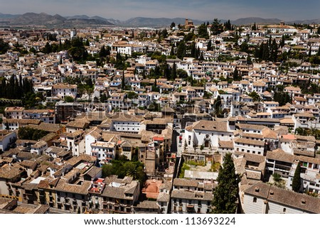 Aerial view of the sprawling city of Granada, Spain with its tile roofs.