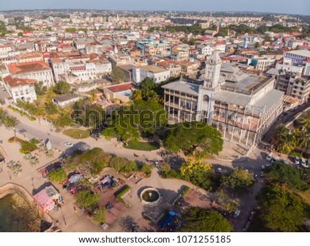 AERIAL view of the Stone Town, old part of Zanzibar City. Flight above main city of Zanzibar, Tanzania, Africa, Indian Ocean #1071255185