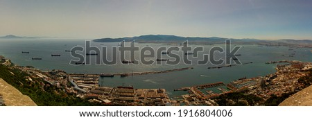 Aerial view of the Strait of Gibraltar taken on the rock of Gibraltar. Image shows hazy horizon with silhouettes of the Rif mountains of North Africa as well as a number of ships crossing the passage Stockfoto ©