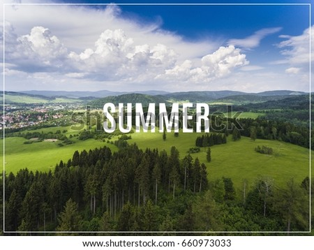 Aerial view of the summertime in mountains. Word Summer.