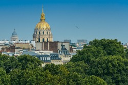 Aerial view of the 7th arrondissement of Paris with the gilded dome of the Saint-Louis-des-Invalides Cathedral.