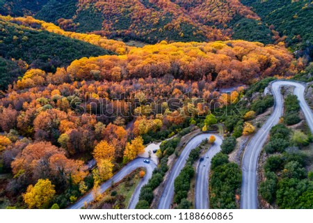 Aerial view of the the Vikos Gorge in the autumn and provincial road with many zigzag in the Epirus Zagorohoria, Greece. National park #1188660865