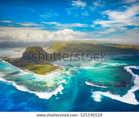 Aerial view of the underwater waterfall and Le Morne Brabant peninsula. Amazing Mauritius landscape