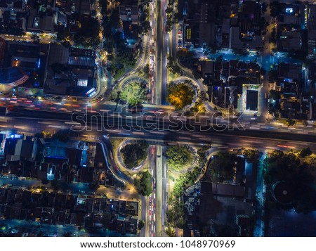 aerial view of the vehicular intersection in Tlalpan avenue in Mexico City at night #1048970969
