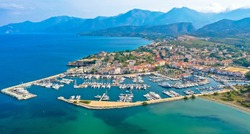 Aerial view of the village of Saint Florent, Corsica. Harbor boats and houses. Saint-Florent or San Fiurenzu in corsican, is a commune in the french department of Haute-Corse region of Corsica.