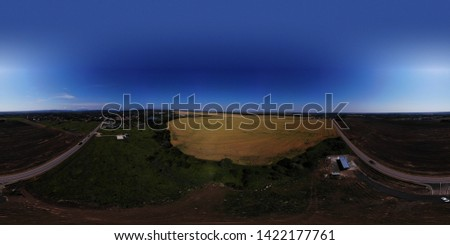 Aerial view of the wheat fields. Wheat fields from a height. Top down view of the wheat fields. Panoramic view of the fields.
