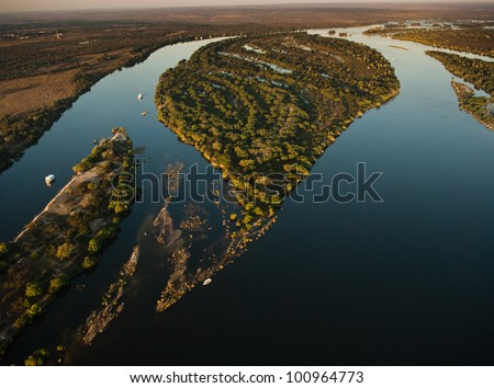 Aerial view of the Zambezi river with riverboats