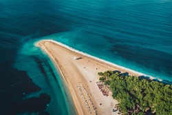 Aerial view of The Zlatni Rat, often referred to as the Golden Cape or Golden Horn, is a spit of land located about 2 kilometres west from the harbour town of Bol on the southern coast of the Croatia