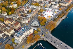 Aerial view of the Zurich Quay bridge where the Limmat river meets lake Zurich and the Bellevue square, an upscale district of the largest city in Switzerland in autumn