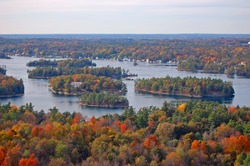 Aerial view of Thousand Islands National Park on St. Lawrence River in fall, from Sky deck on Hill Island, on the border of Ontario in Canada and New York State in USA.