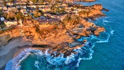 Aerial view of Three Arch Bay in Laguna Beach, Orange County, California during twilight.