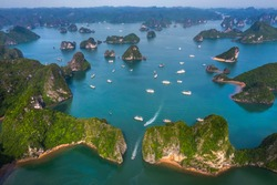 Aerial view of Ti Top rock island area from Luon cave, Halong Bay, Vietnam, Southeast Asia. UNESCO World Heritage Site. Junk boat cruise to Ha Long Bay. Popular landmark, famous destination of Vietnam