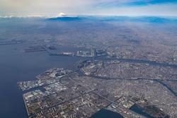 Aerial view of Tokyo Bay and Mount Fuji in Tokyo, Japan.
