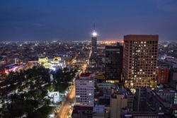 Aerial View of Torre Latinoamericana ( Latin-American Tower) in Mexico City at night time. City center at Mexico night landscape