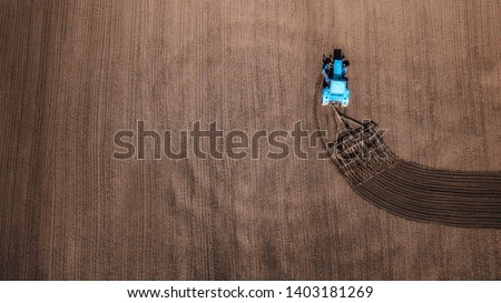 aerial view of tractor , combine cultivating field. drone shot. picture with space for text. Farmland from above #1403181269