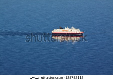 Aerial view of traditional norwegian cruise ship in tranquil blue ocean