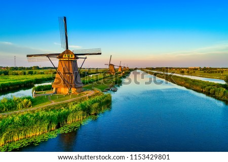 Aerial view of traditional windmills in Kinderdijk, The Netherlands. This system of 19 windmills was built around 1740 and is a UNESCO heritage site. Stock photo ©