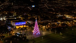 Aerial view of tree christmas with Se church and Madeira flag in Funchal City, Madeira island, Portugal.