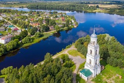 Aerial view of Troitsky cathedral's bell tower and Poshekhonye town on sunny summer day. Yaroslavl Oblast, Russia.